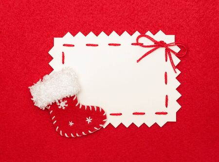 Christmas empty postcard  and Christmas stocking on red background  Stock Photo