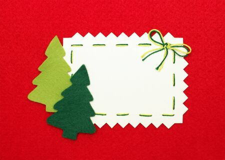 Christmas postcard: empty  blank and  new year trees on red background
