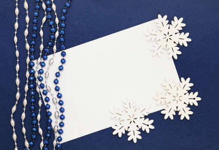 Christmas card: blank and snowflakes on dark blue background
