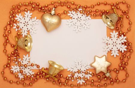 Christmas frame of  snowflakes, bells, beads and baubles