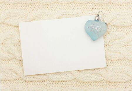snugly: Christmas card   blank and heart on knitting background