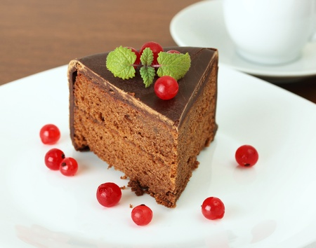 delicious chocolate cake with  red currant and lemon balm photo