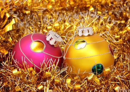 Christmas balls on gold tinsel