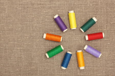 Sewing concept  Colorful  bobbin thread on sacking