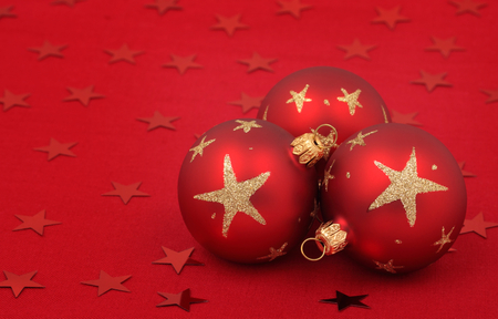 Three christmas balls on red Stock Photo