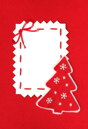 handmade card  Paper Sheet and Christmas tree on red  Stock Photo