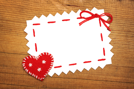Paper Sheet and Christmas  heart on wooden background Stock Photo