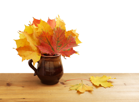Bouquet of autumn maple leaves on wood Stock Photo