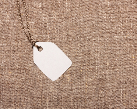 Blank paper label tag on sackcloth photo
