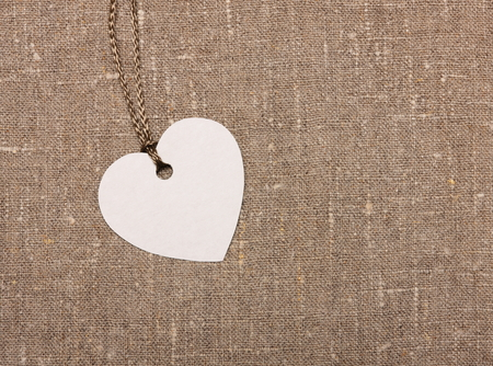 heart shape label tag on sackcloth photo