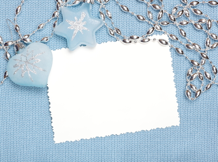 plain stitch: Christmas Blank Paper Sheet with decorations on knitted fabric  Stock Photo