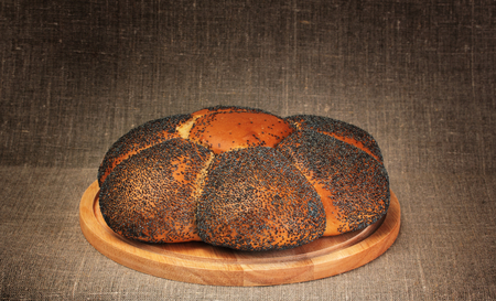 loaf of wheat  bread with poppy seed  on wooden board Stock Photo