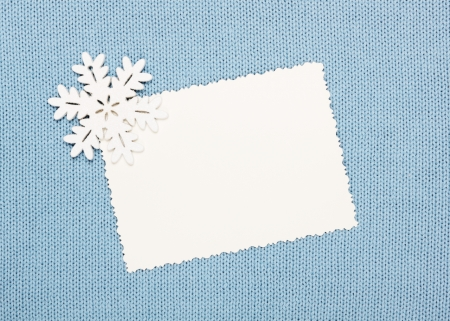 snugly: winter empty  blank and  snowflake on knitted fabric  Stock Photo