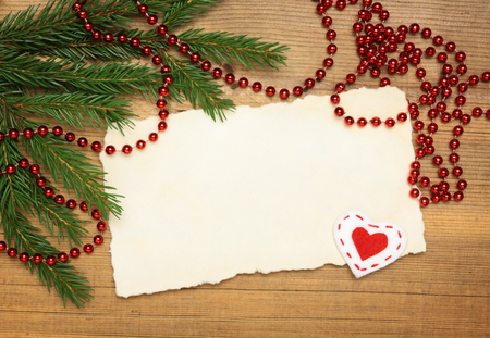 Wooden Blank Old Paper Sheet with Christmas tree and decorations on wooden  photo
