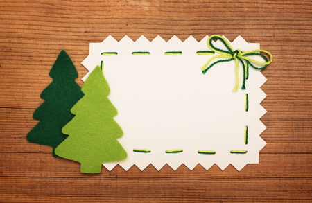 Paper Sheet and felt Christmas tree on wooden  Stock Photo