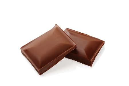 Broken chocolate bar on a white background