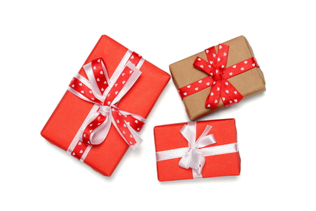 three gift boxes with ribbon bows, isolated on white photo