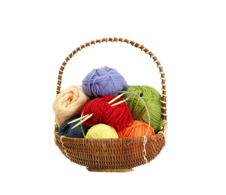 plain stitch: Colorful yarn clews in basket isolated on white