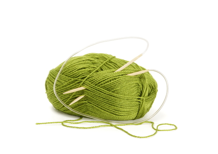snugly: Woollen yarn and knitting needles  Needlework accessories isolated on white  Stock Photo