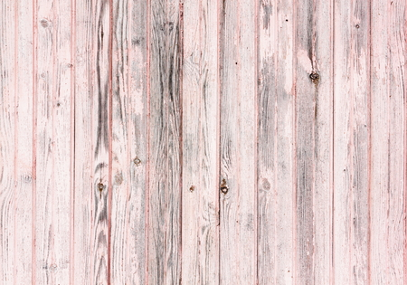 Old wooden painted pink rustic background, paint peeling