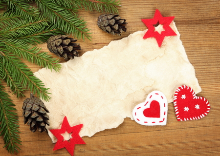 Blank Old Paper Sheet with Christmas tree branches and decorations on wooden background photo