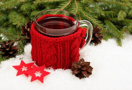snugly: Christmas card. Cup of tea,  Christmas tree branches, cones and felt  decorations