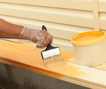 Maintaining of wooden surfaces with protective paint