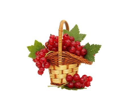 Redcurrant in small basket isolated on white photo