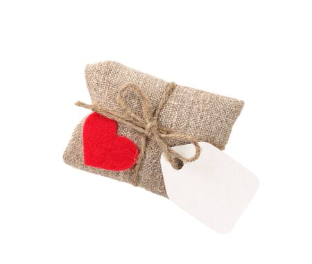 vintage gift in sacking with heart and tag, isolated on white