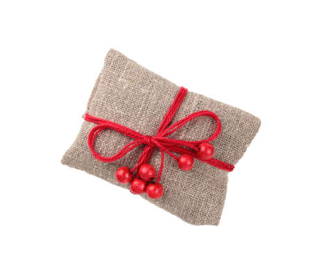 vintage gift in sacking with wooden red beads