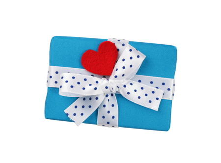 Wrapped blue gift box with ribbon bow and red heart Stock Photo