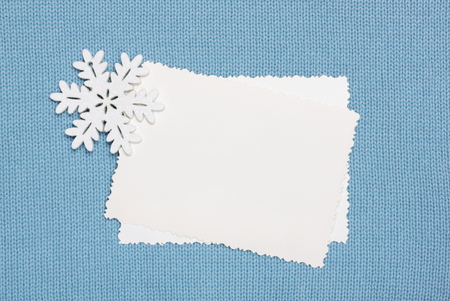 plain stitch: winter background empty blanks and snowflake on knitted fabric