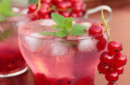 Refreshing summer drink with redcurrant and mint