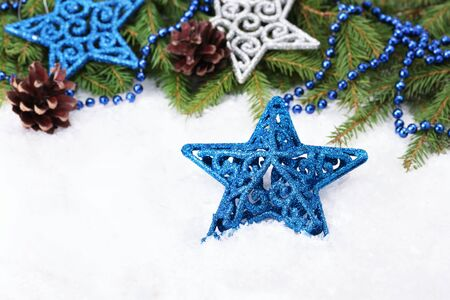 Blue glitter Christmas star decoration and Christmas tree branch Stock Photo