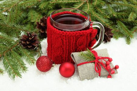 snugly: Christmas card. Cup of tea, Christmas tree branches, vintage rural gift and balls