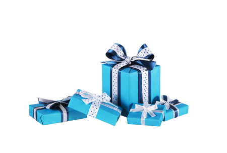 blue christmas background: wrapped blue gift boxes with ribbon bows isolated on white Stock Photo