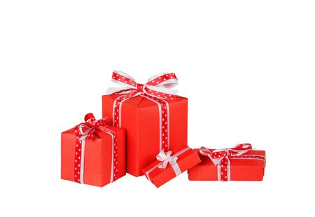 wrapped red gift boxes with ribbon bows isolated on white