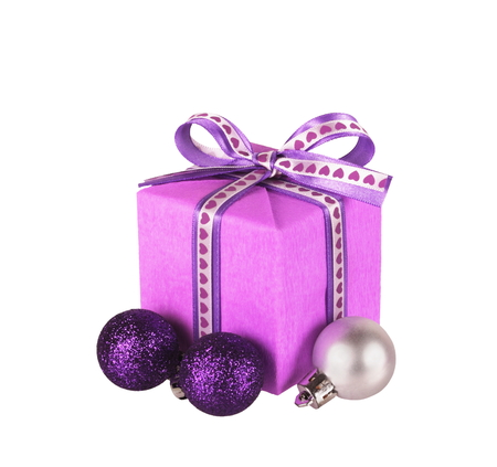 wrapped violet gift box with ribbon bow and christmas balls isolated on white