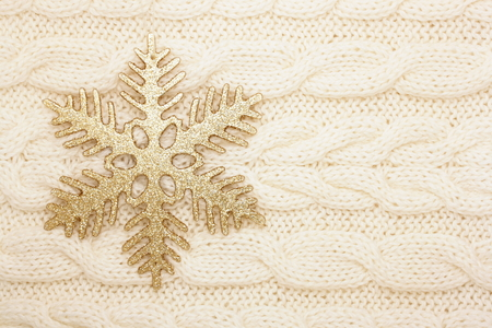 snugly: winter background snowflake on knitted fabric Stock Photo