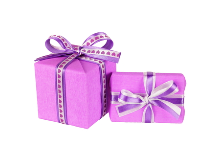 wrapped violet gift boxes with ribbon bows isolated on white Stock Photo