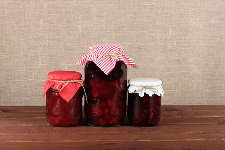 Three glass jars with canned fruits