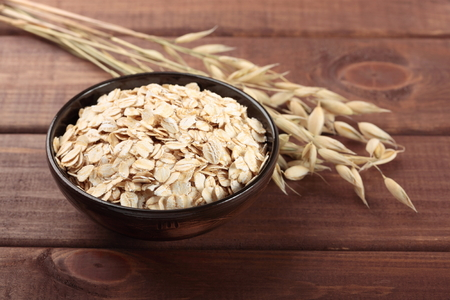 Oat stems and oat flakes Stock Photo