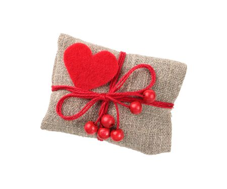 vintage gift in sacking with red heart and beads Stock Photo