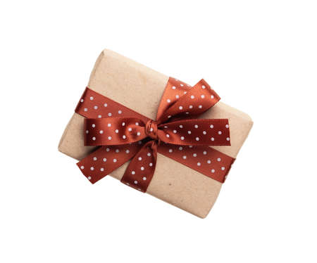 wrapped gift box with ribbon bow isolated on white