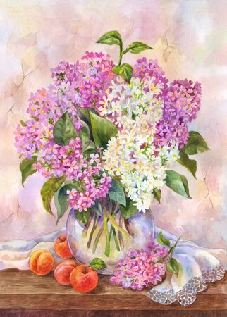Lush bouquet of lilac in a glass vase on a wooden table.