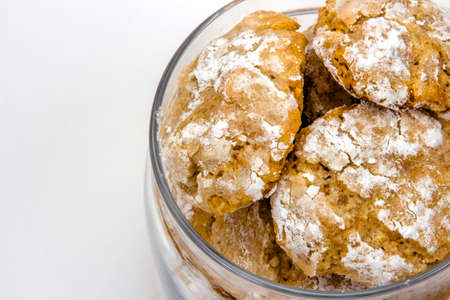 flavored: Amaretti cookies in transparent glass jar close up top view very close up right position