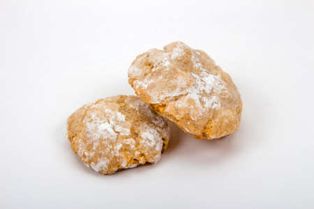sweetstuff: Italian almond biscuits in powdered sugar on a white background, close up