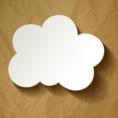 茶色のしわくちゃの紙の中央に白い雲