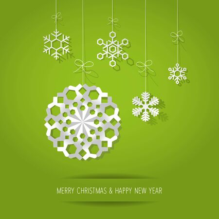 Christmas paper snowflakes on a green background.