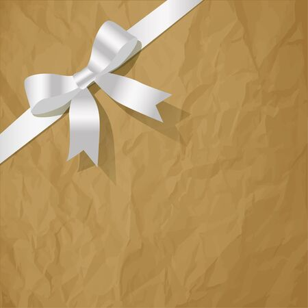 exempted: White pearlribbon on a crumpled paper brown background